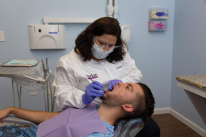 Dentist Raleigh NC Dr. borkan with a patient